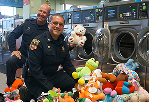 Oshkosh Express Laundry Center and Neenah Police Dept. combine forces for Stuffed Hugs program