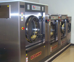 row of washers in an athletic facility