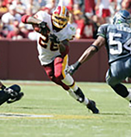 Redskins Football player dodging a tackle