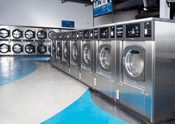 row of high-speed, energy-efficient washers in express laundry center