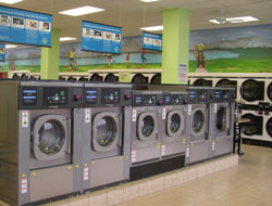 row of energy efficient washer in second story laundromat